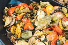 Steamed mix vegetables in big frying pan at street fair. stock image