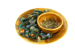 Steamed mussels. With seafood sauce isolated on white background Stock Images