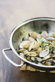 Steamed mussels in garlic and herb sauce stock images