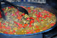 Steamed mussels. Shells and red peppers are cooked on a large baking tray Royalty Free Stock Image