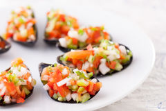 Steamed mussels with vegetable mince Royalty Free Stock Photo