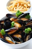Steamed mussels with white wine, and french fries Stock Photos