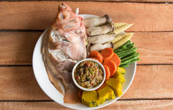 Steamed Nile tilapia  fish and vegetables, served with sauce Royalty Free Stock Photo