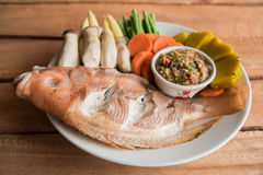 Steamed Nile tilapia  fish and vegetables, served with sauce Royalty Free Stock Photos