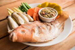 Steamed Nile tilapia  fish and vegetables, served with sauce Stock Photography
