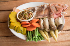 Steamed Nile tilapia  fish and vegetables, served with sauce Stock Images