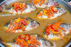 Steamed nile tilapia for sale. In local market Royalty Free Stock Image