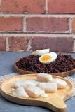 Steamed pangasius dory and riceberry rice on wooden stock photography
