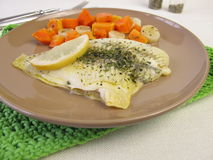 Steamed plaice on vegetables Stock Photography