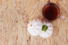 Steamed pork buns, chinese dim sum and hot tea Royalty Free Stock Photos