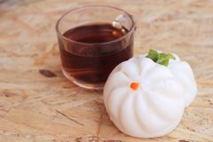 Steamed pork buns, chinese dim sum and hot tea Royalty Free Stock Images