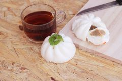 Steamed pork buns, chinese dim sum and hot tea Royalty Free Stock Photo