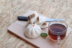 Steamed pork buns, chinese dim sum and hot tea Stock Photo