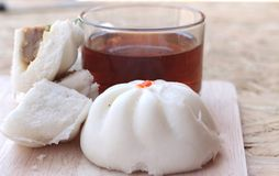 Steamed pork buns, chinese dim sum and hot tea Stock Photos