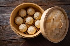 Steamed pork buns in bamboo steamer. Steamed pork buns recipe in bamboo steamer asian food Stock Photos
