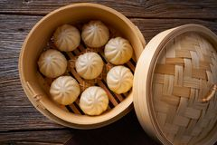 Steamed pork buns in bamboo steamer. Steamed pork buns recipe in bamboo steamer asian food Stock Photography