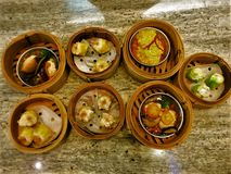 Steamed Pork ,Crab and Shrimp Dumpling In a steaming rattan tray royalty free stock photos