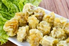 Steamed pork dumplings on white plate. Stock Photo