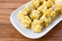 Steamed pork dumplings on white plate. Royalty Free Stock Photo