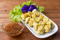 Steamed pork dumplings on white plate. Royalty Free Stock Photo