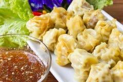 Steamed pork dumplings on white plate. Stock Photography