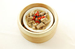 Steamed pork ribs with black bean sauce. Yumcha.   dim sum in bamboo steamer with chinese bun , pao , bao zi , steamed dumpling , shumai on table in chinese Royalty Free Stock Photos