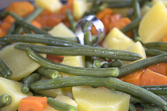 Steamed potatoes french beans and carrots Royalty Free Stock Images