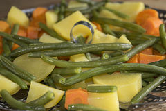 Steamed potatoes french beans and carrots Stock Photos