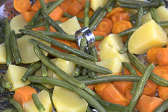 Steamed potatoes french beans and carrots Royalty Free Stock Photography