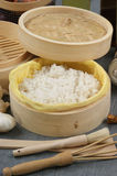 Steamed rice in a bamboo steamer Stock Photo