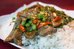 Steamed rice, basil leaves and liver. royalty free stock image