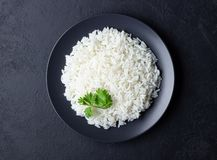 Steamed rice on black plate. Black stone background. Top view royalty free stock photos