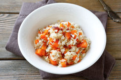 Steamed rice with carrots in a white bowl Stock Photos