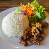 Steamed rice with fried pork. Thai cuisine ,steamed rice with fried pork Royalty Free Stock Images