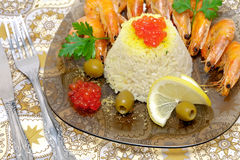 Steamed rice with red caviar and fried shrimp close-up Stock Images