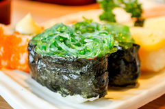 Steamed rice wrapped. In seaweed Stock Image