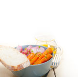 Steamed  root vegetable on a bowl. Bowl of steamed root vegetable on a rustic white wood table Stock Photo