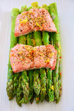 Steamed salmon and asparagus. Fresh wild sockeye salmon and organic asparagus spears cooked in silicone steamer. Vertical format with selective focus Stock Photography