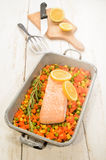 Steamed salmon fillet on finely chopped vegetable Royalty Free Stock Images