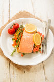 Steamed salmon fillet on finely chopped vegetable Stock Photo