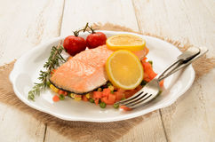 Steamed salmon fillet on finely chopped vegetable Stock Photos