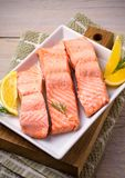 Steamed salmon fish fillet on white plate. Clean eating, healthy and diet food concept. Steamed salmon fish fillet on white plate. Clean eating, healthy and Royalty Free Stock Image
