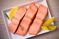 Steamed salmon fish fillet on white plate. Clean eating, healthy and diet food concept. Steamed salmon fish fillet on white plate. Clean eating, healthy and Royalty Free Stock Photo