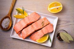 Steamed salmon fish fillet on white plate. Clean eating, healthy and diet food concept. Steamed salmon fish fillet on white plate. Clean eating, healthy and Stock Image