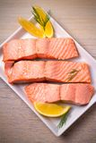 Steamed salmon fish fillet on white plate. Clean eating, healthy and diet food concept. Steamed salmon fish fillet on white plate. Clean eating, healthy and Stock Photography