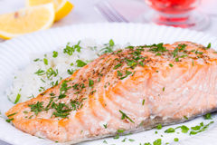 Steamed salmon with fresh herbs and lemon. Rice as a garnish. Royalty Free Stock Photo