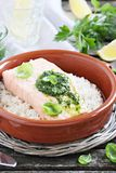 Steamed salmon with pesto and rice garnish Stock Photography