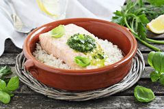 Steamed salmon with pesto and rice garnish Stock Image