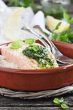 Steamed salmon with pesto and rice garnish Royalty Free Stock Photography