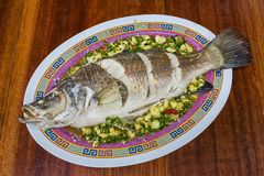 Steamed sea bass with lemon Royalty Free Stock Photo